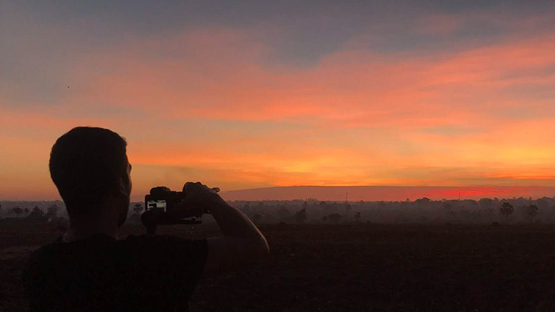 Tomo filming the sunset